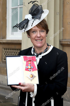 Stock Picture of Dame Caroline Spelman receives an OBE for political and public service