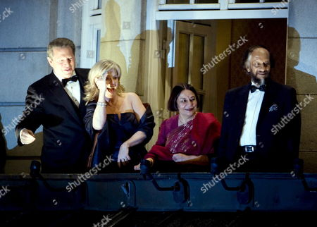 Nobel Peace Prize Winners Al Gore (l) and Rajendra Pachaur (r) with Their Wives Tipper Gore (2-l) and Saroj Pachaur (3-l) Standing on the Balcony of Grand Hotel Viewing a Torchlight Procession Arriving the Grand Hotel in Oslo in Honour of the Nobel Peace Prize Winners 10 December 2007 the Nobel Prizes Winners Received Their Awards at Ceremonies in Stockholm and Oslo 10 December 2007 Norway Oslo