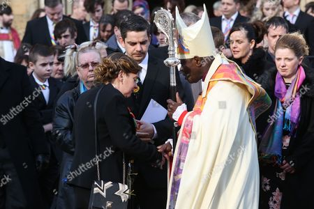 Paul and Alison Rough shake hands with Archbishop of York John Sentamu at York Minster after the funeral of their daughter, 7-year-old daughter Katie Rough.