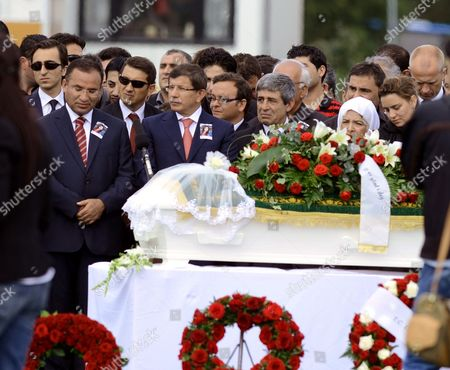 Turkish Minister of Foreign Affairs Ahmet Davutoglu (2-l) Attends the Funeral of Gizem Dogan Aged 17 at Huseby Park in Trondheim Norway 01 August 2011 Gizem Dogan was One of the Victims of the 22 July Shooting Massacre on Utoya Island the Norwegian Parliament 01 August Convened For a Special Ceremony Commemorating the 77 People who Were Killed in the July 22 Twin Attacks in a Bombing in Central Oslo and a Shooting at Nearby Utoya Island at the Ceremony Parliamentary Speaker Dag Terje Andersen Read out the Names of the 77 Killed Saying It was Important to Remember the Message From Survivors of the Attack on the Labour Party Youth Camp at Utoya not to Be Struck by Fear But Stand Up For Democracy Norway Trondheim