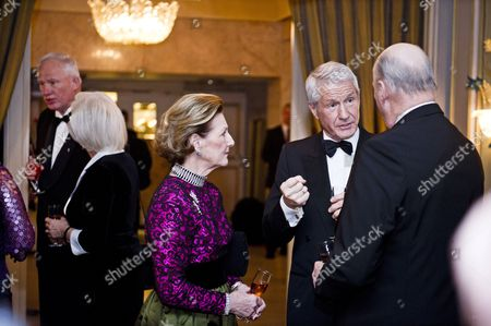 King Harald of Norway (r) Talks to the Chairman of the Norwegian Nobel Committee Torbjoern Jagland (2nd R) and Queen Sonja of Norway (c) As They Arrive at the Norwegian Nobel Prize Committee's Traditional Banquet at the Grand Hotel in Oslo Norway 10 December 2010 at Far Left the Director of the Nobel Institute Geir Lundestad Norway Oslo