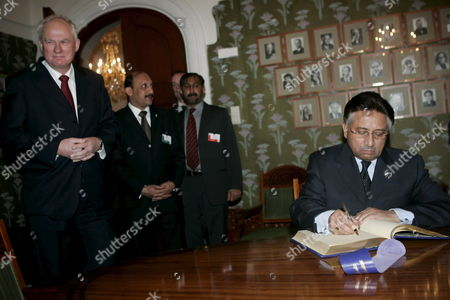 Visiting Pakistani President General Pervez Musharraf (r Signs the Guest Book at the Nobel Institute in Oslo Tuesday 24 January 2006 Left is Obel Institute Director Geir Lundestad Musharraf is on a Two-day Official Visit to Norway Norway Oslo