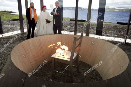 Stock Picture of Norway's Queen Sonja Stands Between Swiss Architect Peter Zumthor (r) and Jerry Gorovoy Inside the Glass House at the Steilneset Memorial in Vardo in the Extreme Northeast of Norway 23 June 2011 Gorovoy was Assistant to the Late French-american Artist Louise Bourgeois who Created the Chair and the Flame in the Glass House Spain Vardo