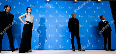 From left, actors Sho Aoyagi, Yao Yiti, director Sabu and actor Chang Chen pose for the photographers during a photo call for the film 'Mr. Long' at the 2017 Berlinale Film Festival in Berlin, Germany
