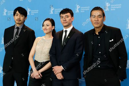 From left, actors Sho Aoyagi, Yao Yiti, Chang Chen and director Sabu pose for the photographers during a photo call for the film 'Mr. Long' at the 2017 Berlinale Film Festival in Berlin, Germany