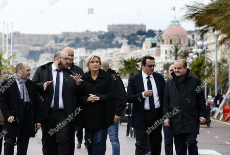 Leader of France's far-right Front National political party and candidate for the 2017 French presidential elections Marine Le Pen (C), Local Politician Philippe Vardon (2-L), Regional Council of the Alpes-Maritimes Olivier Bettati (2-R) and Mayor of Frejus David Rachline (R) visit the 'Promenade des Anglais' in Nice, France, 13 February 2017. A total of 85 people died after a truck drove into the crowd on the famous Promenade des Anglais during celebrations of Bastille Day in Nice, late 14 July 2016.