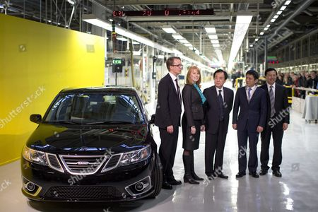 (l-r) Nevs Md Mattias Bergman Swedish Minister of Trade Annie Loof China's Ambassador to Stockholm Chen Yuming Vice Mayor of Xingdao Li Chenggang and State Power Group Ceo Kai Johan Jiang Stands Next to the First Production Nevs (national Electric Vehicle Sweden) 'Saab 9-3 Aero' at the Trollhattan Factory in Sweden 02 December 2013 Saab the Swedish Car Maker That Went Bankrupt Two Years Ago Resumed Production on 02 December Under New Ownership National Electric Vehicle Sweden (nevs) a Chinese-backed Consortium Took Over the Ailing Carmaker Last Year Sweden Trollhattan