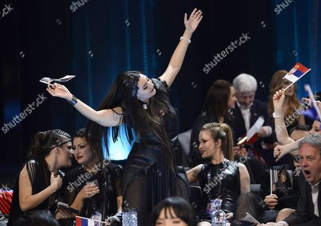 Serbia's Sanja Vucic (c) of Zaa and Her Team Cheer in the Green Room During the Second Semi-final of the 61st Annual Eurovision Song Contest (esc) at the Ericsson Globe Arena in Stockholm Sweden 12 May 2016 the Event's Grand Final Takes Place on 14 May Sweden Stockholm