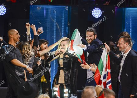 Bulgaria's Poli Genova (c) and Her Team Cheer in the Green Room During the Second Semi-final of the 61st Annual Eurovision Song Contest (esc) at the Ericsson Globe Arena in Stockholm Sweden 12 May 2016 the Event's Grand Final Takes Place on 14 May Sweden Stockholm