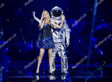 Stock Image of Moldova's Lidia Isac (l) Performs with the Song 'Falling Stars' During the First Semi-final of the 61st Annual Eurovision Song Contest (esc) at the Ericsson Globe in Stockholm Sweden 10 May 2016 the Second Semi-final Takes Place on 12 May and the Grand Final is Held on 14 May Sweden Stockholm