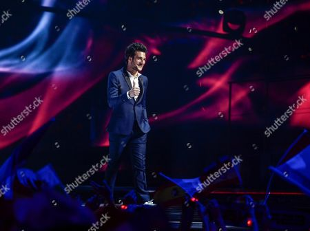 Amir Haddad Representing France Gives a Thumb-up to the Audience During His Arrival on Stage For the Grand Final of the 61st Annual Eurovision Song Contest (esc) at the Ericsson Globe Arena in Stockholm Sweden 14 May 2016 There Are 26 Finalists From As Many Countries Competing in the Grand Final Sweden Stockholm
