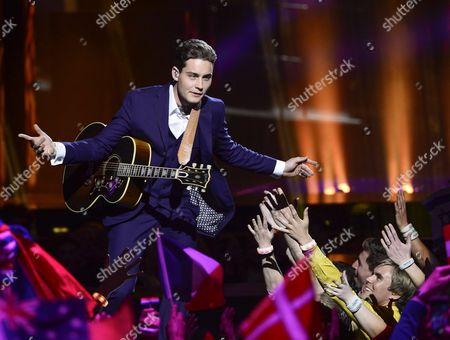 Douwe Bob Representing the Netherlands Performs with the Song 'Slow Down' During the Grand Final of the 61st Annual Eurovision Song Contest (esc) at the Ericsson Globe Arena in Stockholm Sweden 14 May 2016 There Are 26 Finalists From As Many Countries Competing in the Grand Final Sweden Stockholm