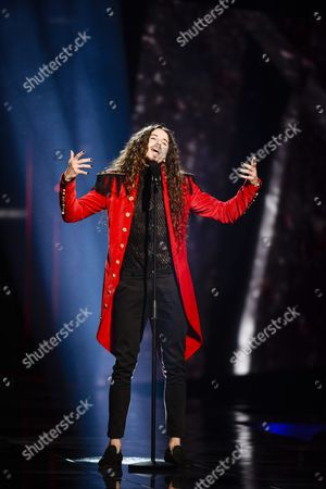 Stock Picture of Michal Szpak Representing Poland Performs with the Song 'Color of Your Life' During the Grand Final of the 61st Annual Eurovision Song Contest (esc) at the Ericsson Globe Arena in Stockholm Sweden 14 May 2016 There Are 26 Finalists From As Many Countries Competing in the Grand Final Sweden Stockholm