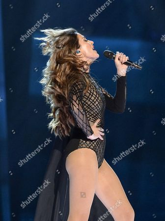 Stock Photo of Iveta Mukuchyan Representing Armenia Performs with the Song 'Love Wave' During the Grand Final of the 61st Annual Eurovision Song Contest (esc) at the Ericsson Globe Arena in Stockholm Sweden 14 May 2016 There Are 26 Finalists From As Many Countries Competing in the Grand Final Sweden Stockholm