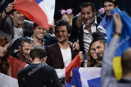 Amir Haddad Representing France (c) and His Team Cheer in the Green Room During the Grand Final of the 61st Annual Eurovision Song Contest (esc) at the Ericsson Globe Arena in Stockholm Sweden 14 May 2016 There Are 26 Finalists From As Many Countries Competing in the Grand Final Sweden Stockholm