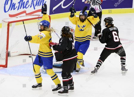 Sweden's Sabina Kuller (24) Och Anna Borgqvist Celebrate After Kuller Scored the Opening Goal Behind Japan's Goal Keeper Nana Fujimoto (partly Hidden) As Japan's Kanae Aoki (5) and Sena Suzuki (6) Look on During the 2015 Iihf Ice Hockey Women's World Championship Group B Match Between Sweden and Japan at Malmo Isstadion in Malmo Southern Sweden on March 28 2015 Sweden Malmo