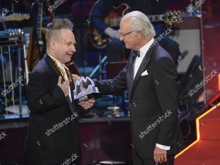 Us Theatre Director Peter Sellars (l) Receives the Swedish Polar Music Prize From Swedish King Carl Gustaf (r) During the Ceremony in Stockholm Sweden 26 August 2014 Sellars Received the Prize For His Innovative Work in the Field of Opera and Music Productions Sweden Stockholm