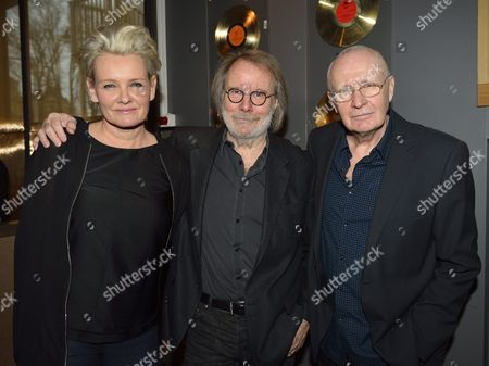 Swedish Musician Benny Andersson (c) of Swedish Pop Group Abba Poses with Singer Eva Dahlgren (l) and Singer/songwriter Ulf Dageby (r) During the Presentation of the Inaugural Twelve Inductees at the Swedish Music Hall of Fame at Djurgarden in Stockholm Sweden 06 February 2014 Sweden Stockholm