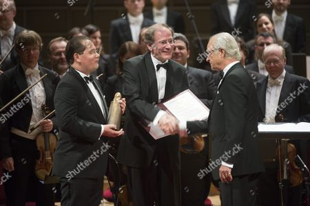 Stock Image of Austrian Andreas Grossbauer (l) Chairman of the Vienna Philharmonic Orchestra and His Precursor Clemens Hellsberg (c) Receive a Figurine and a Diploma From Swedish King Carl Xvi Gustaf (r) During the Award Ceremony of the 'Birgit Nilsson Prize' in the Concert Hall in Stockholm Sweden 08 October 2014 the Vienna Philharmonic Orchestra Will Receive the Music Prize For 2014 in Memory of Swedish Soprano Birgit Nilsson Worth One Million Us Dollars Sweden Stockholm