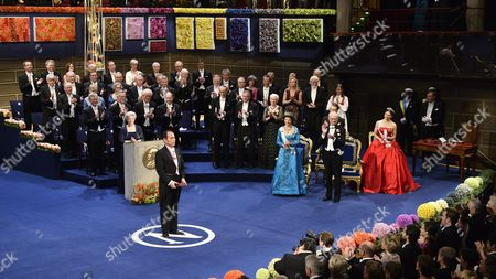 Nobel Physics Laureate Japan's Professor Shuji Nakamura of University of California Santa Barbara Ca Usa Bows After Receiving the Diploma and Medal From King Carl Xvi Gustaf (r) with Queen Silvia and Crown Princess Victoria During the Nobel Award Ceremony at the Concert Hall in Stockholm Sweden 10 December 2014 Sweden Stockholm