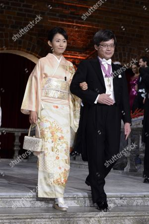 Nobel Physics Laureate Professor Hiroshi Amano (r) of Nagoya University Japan Arrives with Yuki Nakamura (l) Wife of Amano's Fellow Laureate Shuji Nakamura at the Nobel Banquet at the Stockholm Town Hall Sweden 10 December 2014 Sweden Stockholm