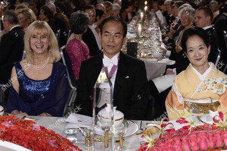 Japanese Physics Nobel Laureate Shuji Nakamura (c) with Professor Evi Heldin (l) and Kasumi Amano (r) Attend the Nobel Banquet at the Stockholm Town Hall Sweden 10 December 2014 Sweden Stockholm