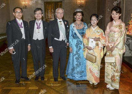 (l-r) Japanese Physics Nobel Laureates Shuji Nakamura and Kasumi Amano with Swedish King Carl Xvi Gustaf Queen Silvia Kasumi Amano and Yuki Nakamura Pose After the the Nobel Banquet at the Stockholm Town Hall Sweden 10 December 2014 Sweden Stockholm