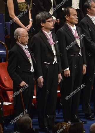 (l-r) Nobel Physics Laureates Professor Isamu Akasaki and Professor Hiroshi Amano of Nagoya University Japan; Isamu Akasaki of Shuji Nakamura of California University Santa Barbara Stand During the Nobel Award Ceremony at the Concert Hall in Stockholm Sweden 10 December 2014 Sweden Stockholm