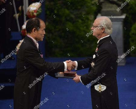 Japanese Nobel Physics Laureate Professor Shuji Nakamura (l) of University of California Santa Barbara Ca Usa Receives the Diploma and Medal From King Carl Xvi Gustaf (r) During the Nobel Award Ceremony at the Concert Hall in Stockholm Sweden 10 December 2014 Sweden Stockholm