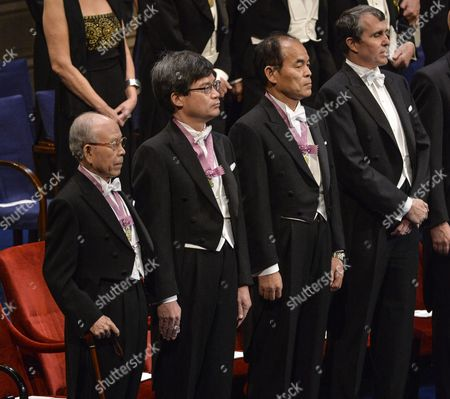 (l-r) Nobel Physics Laureates Professor Isamu Akasaki and Professor Hiroshi Amano of Nagoya University Japan; Isamu Akasaki of Shuji Nakamura of California University Santa Barbara Stand Together with Nobel Chemistry Laureate Eric Betzig Janelia Research Campus Howard Hughes Medical Institute Ashburn Va Usa During the Nobel Award Ceremony at the Concert Hall in Stockholm Sweden 10 December 2014 Sweden Stockholm