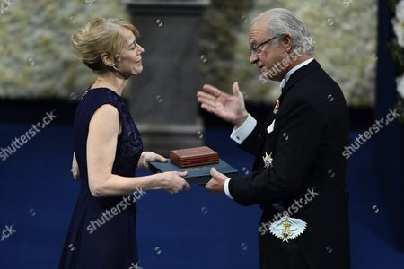 Stock Image of Jenny Munro (l) Daughter of 2013 Nobel Literature Prize Winner Canadian Alice Munro (unseen) Receives the Nobel Prize Award From the Hands of Sweden's King Carl Xvi Gustaf at a Formal Ceremony in Stockholm Sweden 10 December 2013 the Nobel Price Foundation on 10 December is Awarding the 2013 Nobel Prize Winners in the Categories of Medicine Physics Chemistry Literature and Economics the Laureates Will Receive Their Awards From the Hands of Sweden's King Carl Xvi Gustaf at a Formal Ceremony Followed by a Gala Banquet Sweden Stockholm