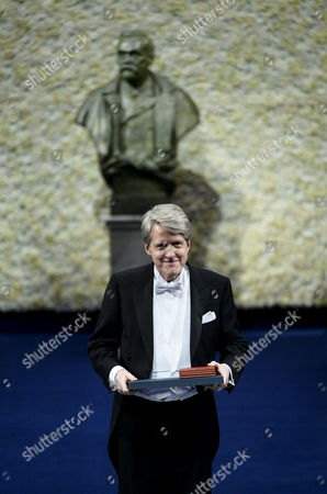 Stock Photo of The 2013 Nobel Economics Prize Winner Us Robert J Shiller Holds the Nobel Prize Award at a Formal Ceremony in Stockholm Sweden 10 December 2013 the Nobel Price Foundation on 10 December is Awarding the 2013 Nobel Prize Winners in the Categories of Medicine Physics Chemistry Literature and Economics the Laureates Will Receive Their Awards From the Hands of Sweden's King Carl Xvi Gustaf at a Formal Ceremony Followed by a Gala Banquet Sweden Stockholm