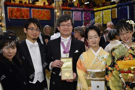 Nobel Physics Laureate Professor Hiroshi Amano (c) of Nagoya University Japan Poses with His Nobel Medal Together with His Family - His Wife Kasumi Amano (2-r) After Receiving It From the Swedish King During the Nobel Award Ceremony at the Concert Hall in Stockholm Sweden 10 December 2014 the Nobel Prize in Physics 2014 was Awarded Jointly to Isamu Akasaki Hiroshi Amano and Shuji Nakamura For the Invention of Efficient Blue Light-emitting Diodes Which Has Enabled Bright and Energy-saving White Light Sources Sweden Stockholm