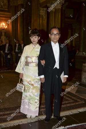 Japanese Nobel Physics Laureate Shuji Nakamura Right and Yuki Nakamura Left Arrive at the Royal Palace in Stockholm Sweden 11 December 2014 Sweden Stockholm