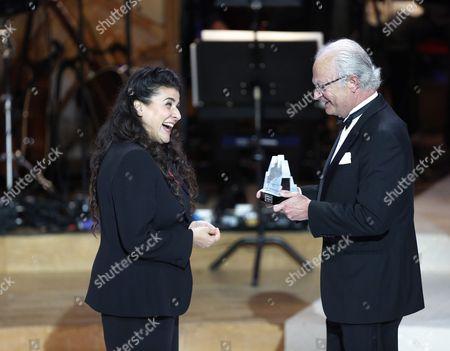 Stock Photo of Italian Mezzo-soprano Cecilia Bartoli (l) Receives Her Polar Music Prize From Sweden's King Carl Gustaf During the Award Ceremony in the Concert Hall in Stockholm Sweden 16 June 2016 Sweden Stockholm