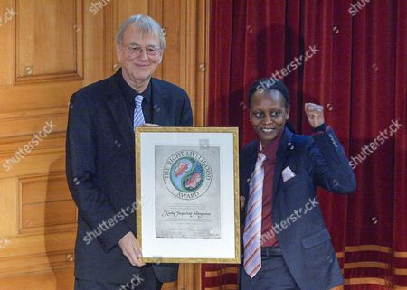 Stock Picture of Kasha Jacqueline Nabagesera (r) Receives the Prize From Jakob Von Uexkull (l) the Founder of the Right Livelihood Award For Working For the Rights of Lgbti People in Uganda in Stockholm Sweden 30 November 2015 Sweden Stockholm