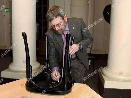 British Physicist and Nobel Peace Prize Laureate 2016 J Michael Kosterlitz Shows the Chair He Signed During the Nobel Laureates Chair Signing Ceremony at the Nobel Museum in Stockholm Sweden 06 December 2016 Laureates Signing Their Own Chairs is a Tradition at the Museum Sweden Stockholm