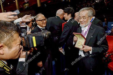 Nobel Physics Laureate Japanese Biologist Yoshinori Ohsumi Poses For Photos with His Nobel Prize at the 2016 Nobel Prize Award Ceremony at the Stockholm Concert Hall in Stockholm Sweden 10 December 2016 Sweden Stockholm