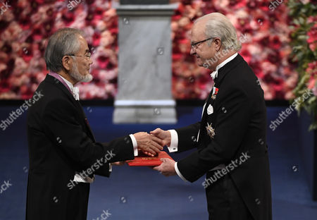 Nobel Physics Laureate and Japanese Biologist Yoshinori Ohsumi (l) Receives the Nobel Prize From King Carl Gustaf (r) of Sweden Attend the 2016 Nobel Prize Award Ceremony at the Stockholm Concert Hall in Stockholm Sweden 10 December 2016 Sweden Stockholm