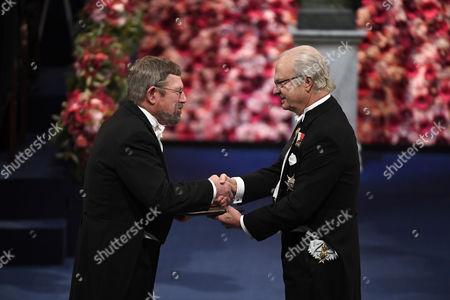 Stock Photo of Nobel Physics Laureate and British Born-american Physicist J Michael Kosterlitz (l) Receives the Nobel Prize From King Carl Gustaf (r) of Sweden Attend the 2016 Nobel Prize Award Ceremony at the Stockholm Concert Hall in Stockholm Sweden 10 December 2016 Sweden Stockholm
