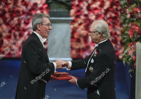 Nobel Physics Laureate and French Chemist Jean-pierre Sauvage (l) Receives the Nobel Prize From King Carl Gustaf (r) of Sweden Attend the 2016 Nobel Prize Award Ceremony at the Stockholm Concert Hall in Stockholm Sweden 10 December 2016 Sweden Stockholm
