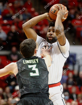 Stock Photo of Texas Tech forward Aaron Ross shoots in front of Baylor guard Jake Lindsey during the first period of an NCAA college basketball game, in Lubbock, Texas