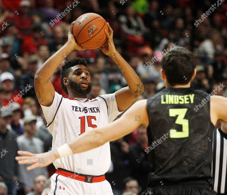 Stock Image of Texas Tech forward Aaron Ross looks for an open teammate defended by Baylor guard Jake Lindsey during the second period of an NCAA college basketball game, in Lubbock, Texas