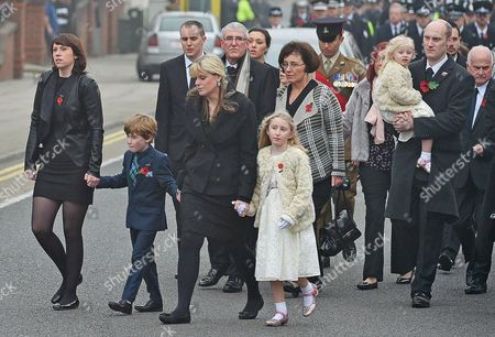 Funeral Of Murdered Merseyside Police Officer Pc Dave Phillips At Liverpool Anglican Cathedral.- Wife Jen With Daughter Abigail (centre) Walk Behind Her Husbands Coffin Along Upper Duke St. In Liverpool City Centre.