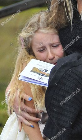Funeral Of Murdered Merseyside Police Officer Pc Dave Phillips At Liverpool Anglican Cathedral Liverpool Merseyside.-pc Phillips Daughter Abigail Looks At Her Father In The Order Of Service Book Held By Mother Jen.