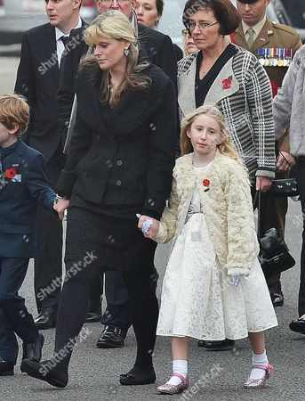 Funeral Of Murdered Merseyside Police Officer Pc Dave Phillips At Liverpool Anglican Cathedral. Wife Jen (blonde) With Daughter Abigail Walk Behind Her Husbands Coffin Along Upper Duke St. In Liverpool City Centre.