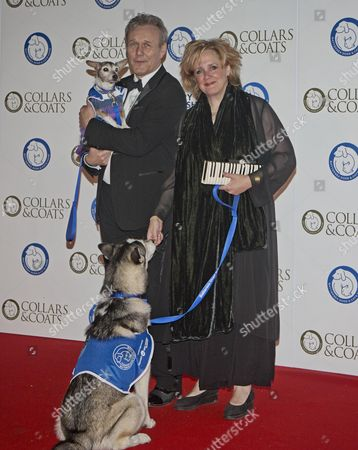 Editorial image of Battersea Dogs Home Collars And Coats Gala Ball - Anthony Head And Sarah Fisher.