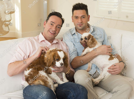 Stock Photo of 'strictly Come Dancing' Judge Craig Revel Horwood With His Partner Damon Scott And Their Two Dogs Sophie Who Has A Terminal Heart Condition And New Puppy Charlie A Rescue Dog From Battersea Dog Trust.