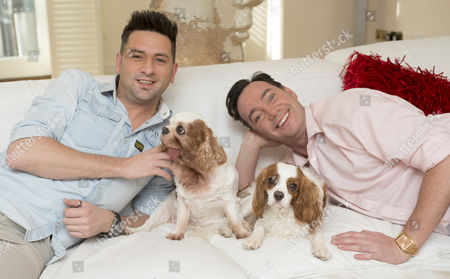 Stock Image of 'strictly Come Dancing' Judge Craig Revel Horwood With His Partner Damon Scott And Their Two Dogs Sophie Who Has A Terminal Heart Condition And New Puppy Charlie A Rescue Dog From Battersea Dog Trust.
