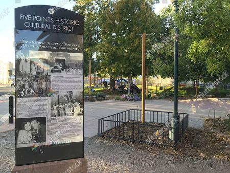 """A sign with historic photos celebrates Denver's Five Points, a neighborhood that was called """"The Harlem of West,"""" in Denver, Colo. Five Points is where Billie Holiday, Count Basie and Miles Davis performed and novelist Jack Kerouac wrote part of """"On The Road."""" The historic black neighborhood is facing gentrification with new breweries and coffee shops near buildings that once housed jazz clubs and consequential black-owned businesses"""